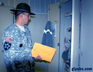 Drill sergeant inspects a locker