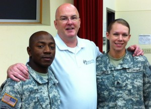 Mark poses with Staff Sergeants Miller and Aldrich, winners of the ALC Leadership Board and Master Fitness Award respectively