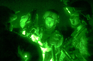 Soldiers in Iraq perform a precombat inspection